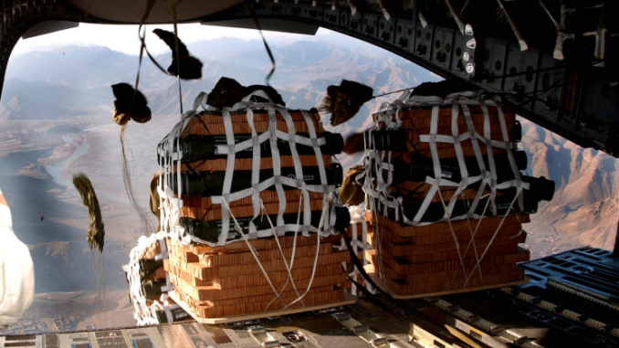 C17 bundle drop over a remote U.S. camp in Afghanistan. (Photo by Senior Airman Ricky J. Best, 2 Jan 2007).