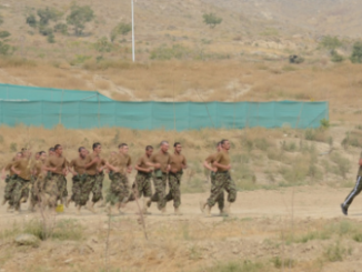 Cadets running at the ANAOA. (Photo by SSG Richard Andrade, ISAF, 23 Oct 2013).