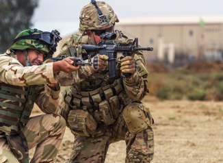 SFABs - Member of 82nd Abn Div trains an Iraqi soldier at Camp Taji, Iraq. (Credit U.S. Army/ SGT Cody Quinn)