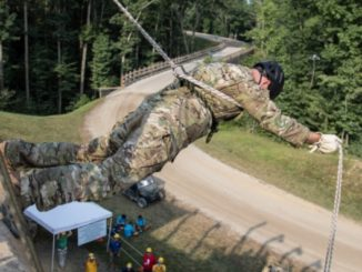 Soldier with 5th SFGA demonstrates Australian Rappel at Boy Scout National Jamboree in West Virginia. (Photo by SSG Matt Britton, 22nd Mobile Public Affairs, US Army, July 21, 2017).
