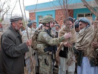A member of an Agricultural Development Team (ADT) talks with an Afghan villager about crops. (Photo U.S. Army SPC Leslie Goble, 2012). Jeff Goodson article on development in conflict areas.