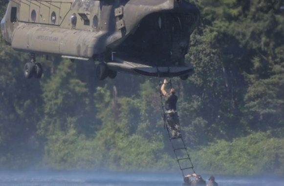 1st SFGA Soldier ascends a ladder to board helicopter while conducting water operations training. (Photo by SGT Codie Mendenhall, July 25, 2017).
