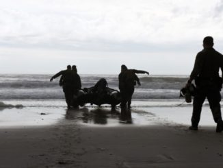 Marines with Hotel Company, 2nd Raider Battalion, Marine Corps Forces Special Operations Command (MARSOC) in Camp Lejeune, North Carolina, carry a Zodiac Rigid Hull Inflatable Boat into the surf at Onslow Beach on base, March 28, 2017. (Photo by Petty Officer 3rd Class Corinne Zilnicki, U.S Coast Guard).