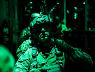 Soldier from the 10th Special Forces Group at Fort Carson, Colorado prepares for a night static line parachute jump from a C-130 aircraft. (Photo by SGT Connor Mendez, U.S. Army, October 24, 2017).