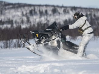 10th Special Forces member on a snow machine during a four week long winter warfare training exercise in Sweden. (photo by SSG Matthew Britton, SOCEUR, February 28, 20180.