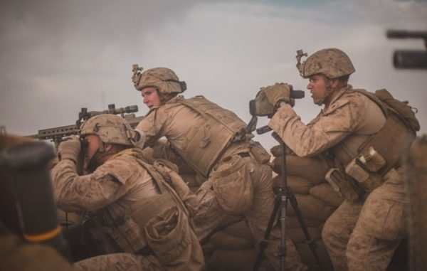 U.S. Marines from Task Force South West react to enemy indirect fire during advising mission with ANA's Operation Maiwand 12 at Camp Shorsrack, Afghanistan. (Photo by SGT Conner Robbins, USMC, March 9, 2018.)