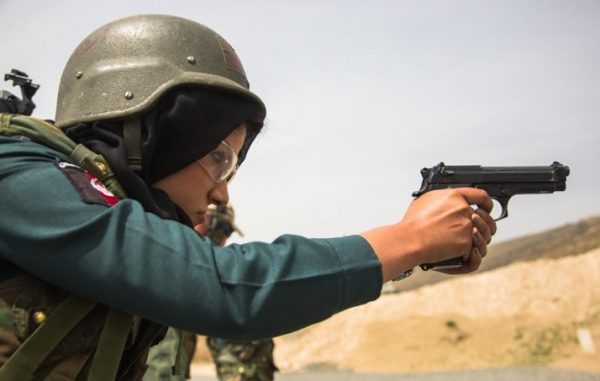 Female Police Officer of the Afghan General Command of Police Special Units fires pistol on range. (Photo by SPC Austin Boucher, NATO Special Operations Component Command - Afghanistan, Apr 4, 2018).
