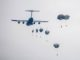 Paratroopers descend from a US Air Force cargo transport. (Photo USAF December 1, 2017).