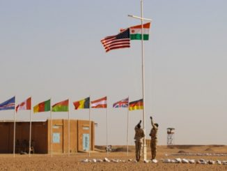 The Nigerien and American flags are raised at the opening ceremony of Flintlock 2018 at Agadez, Niger. (photo Capt Eric Smith, AFRICOM, April 11, 2018).
