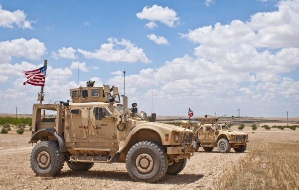 US tactical vehicle provides security on roads near Manbij, Syria. Photo by Staff Sgt. Timothy Koster, Combined Joint Task Force - Operation Inherent Resolve, June 20, 2018.