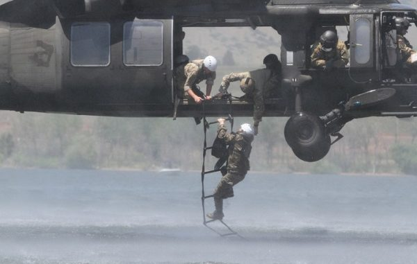 Soldier from 10th Special Forces Group climbs a ladder during water extraction on Chatfield Reservoir near Littleton, Colorado. Photo by SSG Brandon McIntosh, 10th SFGA, Sep 3, 2012.