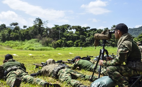 A Colombian competitor uses his Data of Previous Engagement (DOPE) during the zeroing of weapons for this year's Fuerzas Comando, July 15, 2018 on a shooting range in Panama City, Panama. Fuerzas Comando is an annual multinational special operational forces skills competition sponsored by U.S. Southern Command and hosted this year by the Ministry of Public Security, Panama. Through friendly competition, this exercise promotes interoperability, military-to-military relationships, increases training knowledge, and improves regional security. (U.S. Army Photo by Staff Sgt. Brian Ragin/Released)