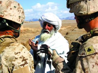 Marines talking with Afghan elder in Helmand province. Photo by Gunnery Sergeant Bryce Piper, USMC, 2011. Photo in July 2018 SIGAR report.