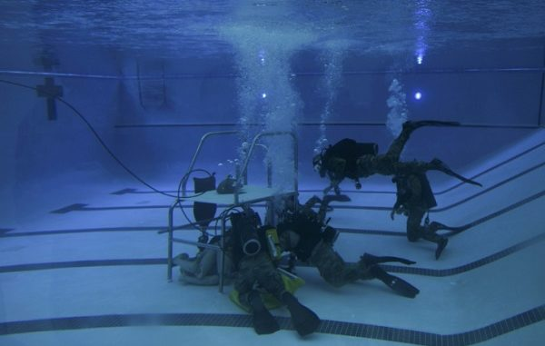 Special Tactics Airmen in pool dive training. Photo by Airman 1st Class Dennis Spain, 1st Special Operations Wing Public Affairs, Hurlburt Field, Florida, July 17, 2018.