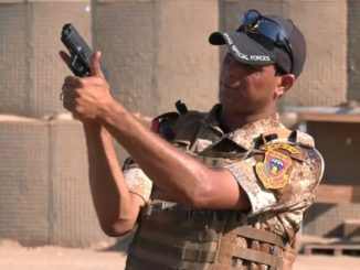 A Iraqi Counter-Terrorism Service instructor shows the correct way to hold and aim a 9mm pistol. Photo from video by CJTF-OIR, SGT Rodney Roldan, August 1, 2018.