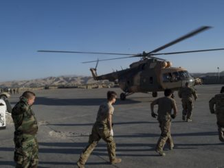 Medical team members rush to an Afghan Mi-17 helicopter with wounded soldiers. The ANA 209th Corps abandoned Camp Gormach, Faryab province. Photo by SrA Nicholas Dutton, USAF, RS HQs.
