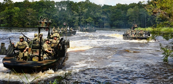Small Boat Team 22 performs a simulated hot extraction utilizing Special Operations Craft Riverine. Photo by Angela Fry, NSCITTS, Sep 7, 2018.