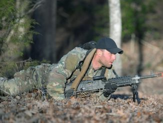 SFQC Candidate low crawls with M240B machine gun during in Robin Sage. Photo by Ken Kassens, SWCS, Dec 12, 2018.