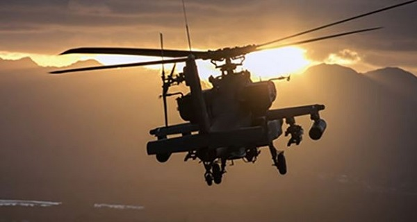 A U.S. Army AH-64 Apache helicopter flies at Schofield Barracks, Hawaii, Dec. 17, 2018. (U.S. Army photo by 1st Lt. Ryan DeBooy)